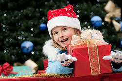 Child Receiving Presents During Christmas