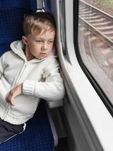 bigstock-Boy-Looking-Out-Train-Window-108511826.jpg